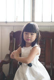 Asian child. Portrait of little Asian girl in white gown dress Royalty Free Stock Photography