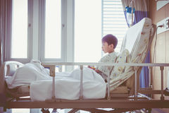 Asian child admitted at hospital room with infusion pump intrave Stock Photography