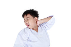 Asian child athletes taekwondo have a neck pain. Isolated on whi. Accidents in sports. Asian child athletes taekwondo have a neck pain. Isolated on white Stock Image