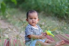 Asian child boy sit on Thai mat in the garden. Asian child boy sit on Thai mat in the garden,concept of learning and health Stock Photography