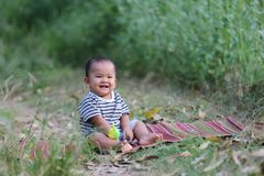Asian child boy sit on Thai mat in the garden. Asian child boy sit on Thai mat in the garden,concept of learning and health Stock Photos