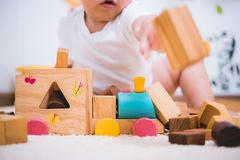 Asian child building playing toy blocks wood. Indoors room royalty free stock photography