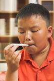 Asian child with a digital thermometer Stock Photo