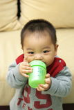 Asian child drinking Stock Image