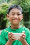 Asian Child Eating The Breakfast. Asian child enjoy to eating the breakfast outdoor Stock Photography