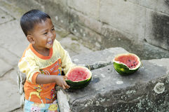 Asian child eating fruit in cambodia Stock Image