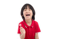 Asian child eating a lollipop on white background Royalty Free Stock Photography