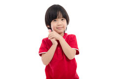 Asian child eating a lollipop on white background Royalty Free Stock Photo