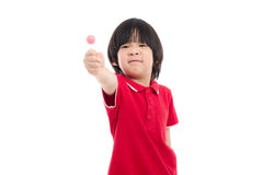 Asian child eating a lollipop on white background Stock Image