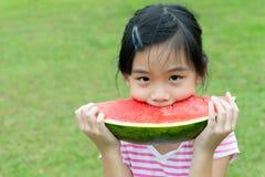 Asian child eating watermelon Stock Photo