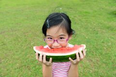 Asian child eating watermelon Royalty Free Stock Photos