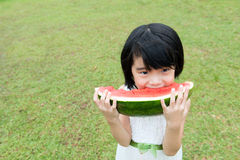 Asian child eating watermelon Royalty Free Stock Image