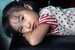 Asian child feel lonely in the dark room Stock Photo