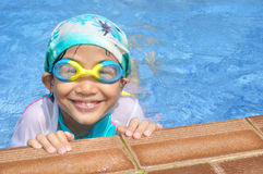 Asian child feel tired in swimming pool Stock Photography