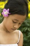 Asian child with flower in her hair Royalty Free Stock Photos