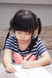 Asian child (four years old) drawing on paper Royalty Free Stock Photography