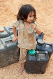 Asian child with gasoline canister Stock Photos