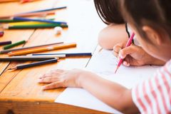 Asian child girl drawing and painting with her friend. With fun together stock photos
