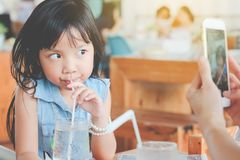 Asian child girl drinking water royalty free stock photography