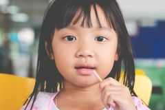 Asian child girl happy eating snack royalty free stock images