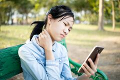 Free Asian Child Girl Holding Smartphone In Hand, Massage Her Neck,bending Head Reated To The Pressure On The Spine,stiff Neck,muscles Stock Photography - 170670062