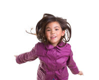 Asian child girl jumping happy with winter purple coat. Moving hair on white royalty free stock photo