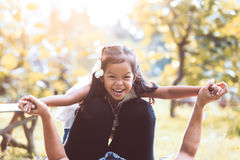 Asian child girl laughing and having fun to play Royalty Free Stock Photo