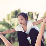 Asian child girl laughing and having fun to play with mother Stock Photography