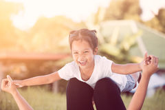 Asian child girl laughing and having fun to play with mother Royalty Free Stock Photos