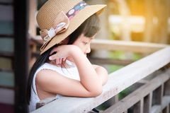 Asian child girl in a lonely mood. Depressed and anxious royalty free stock photo