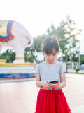 Asian child girl play smart phone Stock Images