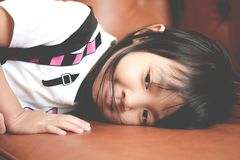 Asian child girl in a sad mood lonely stock images