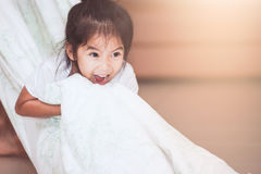 Asian child girl smiling and having fun to play with blanket Stock Photography