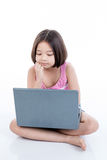 Asian child girl using laptop and thinking Stock Images