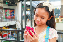 Asian child girl using smartphone Royalty Free Stock Photo