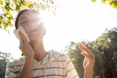 Free Asian Child Girl Wiping Sweat On Her Face With Tissue Paper Suffer From Sunburn Very Hot In Summer Weather Problem Feel Faint, Royalty Free Stock Photos - 168776068