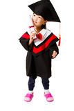 Asian Child Graduation. Chinese little girl graduation in white backround studio shot Stock Photography