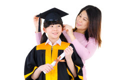 Asian child in graduation gown Royalty Free Stock Photo