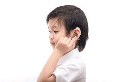 Asian child with hearing aid. Cute Asian child with hearing aid on white background isolated Royalty Free Stock Photography