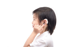 Asian child with hearing aid. Cute Asian child with hearing aid on white background isolated Royalty Free Stock Image
