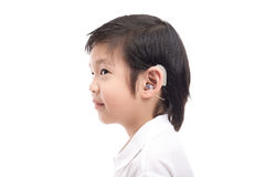 Asian child with hearing aid. Cute Asian child with hearing aid on white background isolated Royalty Free Stock Photos