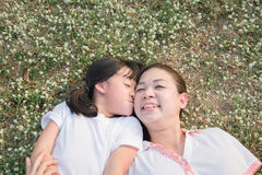 Asian child and her mother laying down Stock Photos