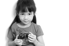 Asian child is holding alarm clock, black and white Stock Image