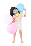 Asian child holding balloons Royalty Free Stock Photos