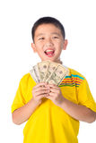 Asian child holding money while standing isolated on white backg royalty free stock images