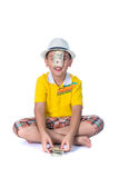 Asian child holding money while standing isolated on white backg. Successful Asian child. Happy child with white hat holding money, isolated on white background Stock Photo
