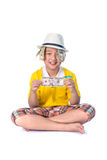 Asian child holding money while standing isolated on white backg. Successful Asian child. Happy child with white hat holding money, isolated on white background Royalty Free Stock Images
