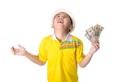 Asian child holding money while standing isolated on white backg. Successful Asian child. Happy child with white hat holding money, isolated on white background Royalty Free Stock Photos