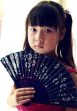 Asian child Holding the Paper fan Royalty Free Stock Image