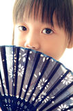 Asian child Holding the Paper fan Stock Image